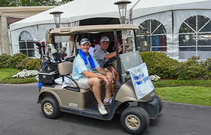 Golfers Wave from Golf Cart (2018)